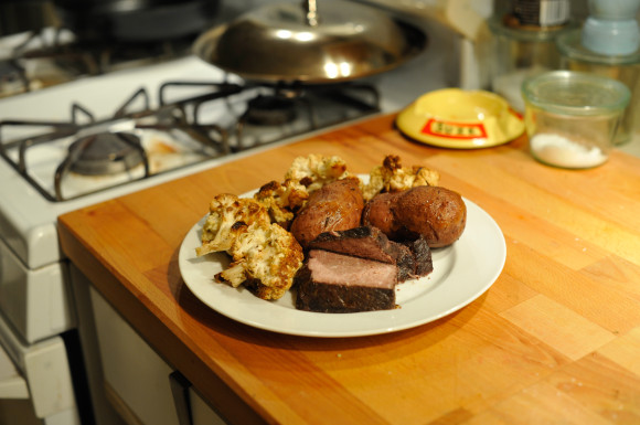 Pot roast potatoes and roasted cauliflower